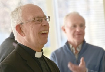Father Rose laughs - Father Rose, the workhorse, gets a warm sendoff