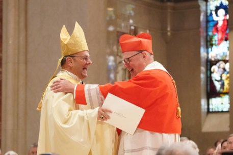 Bishop Cunningham and Cardinal Dolan share a laugh following the cardinal's remarks during the liturgy. (Sun photo | Chuck Wainwright)