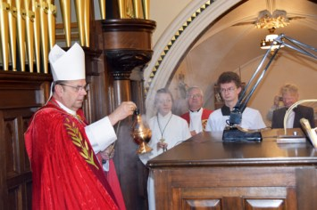 bishop blesses console
