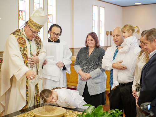 unnamed - Students receive Sacrament of Baptism during Catholic Schools Week