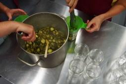 Filling the jars.