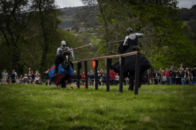 Sudeley Castle Medieval Jousting Show 2017 - Dark Knight against Blue Knight, The Cavalry of Heroes Knights on Horsebackat Sudeley Castle Medieval Jousting Show 2017, Gloucestershire. Family Entertainment for shows and events, with main arena acts and displays