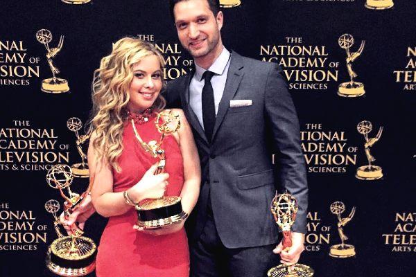 Todd Kapostasy and his wife Tara Lapinski with Emmy awards