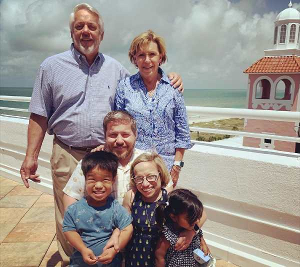 Dr. Jennifer Arnold along with her husband, kids and parents