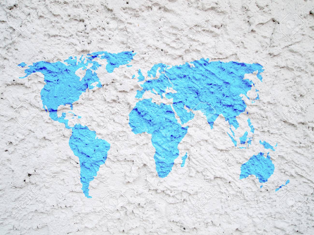world map on white cement wall