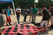 Students playing a game of checkers on Central's patio during Earth Day. Photo Credit: Emma Helstrom (277)