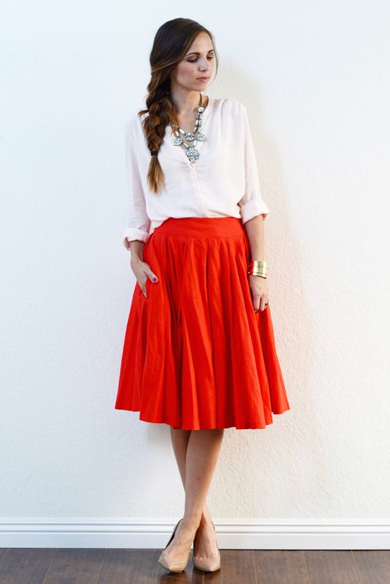 White top and red skirt
