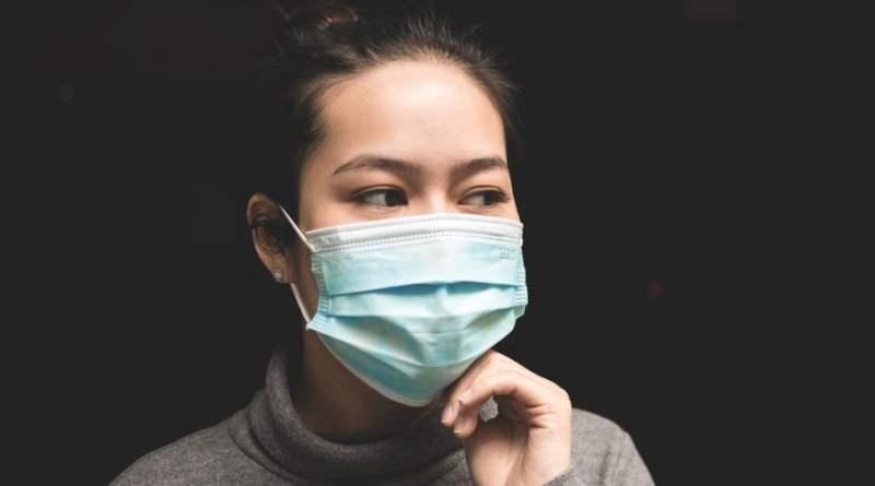 Coronavirus - woman in Wuhan wearing Mask