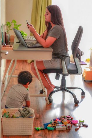 Mother working and son playing