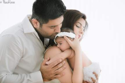 Yuvika with her newborn and husband