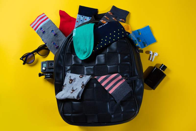 A backpack with men socks