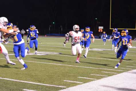 Chargers roll past Patriots in Homecoming game
