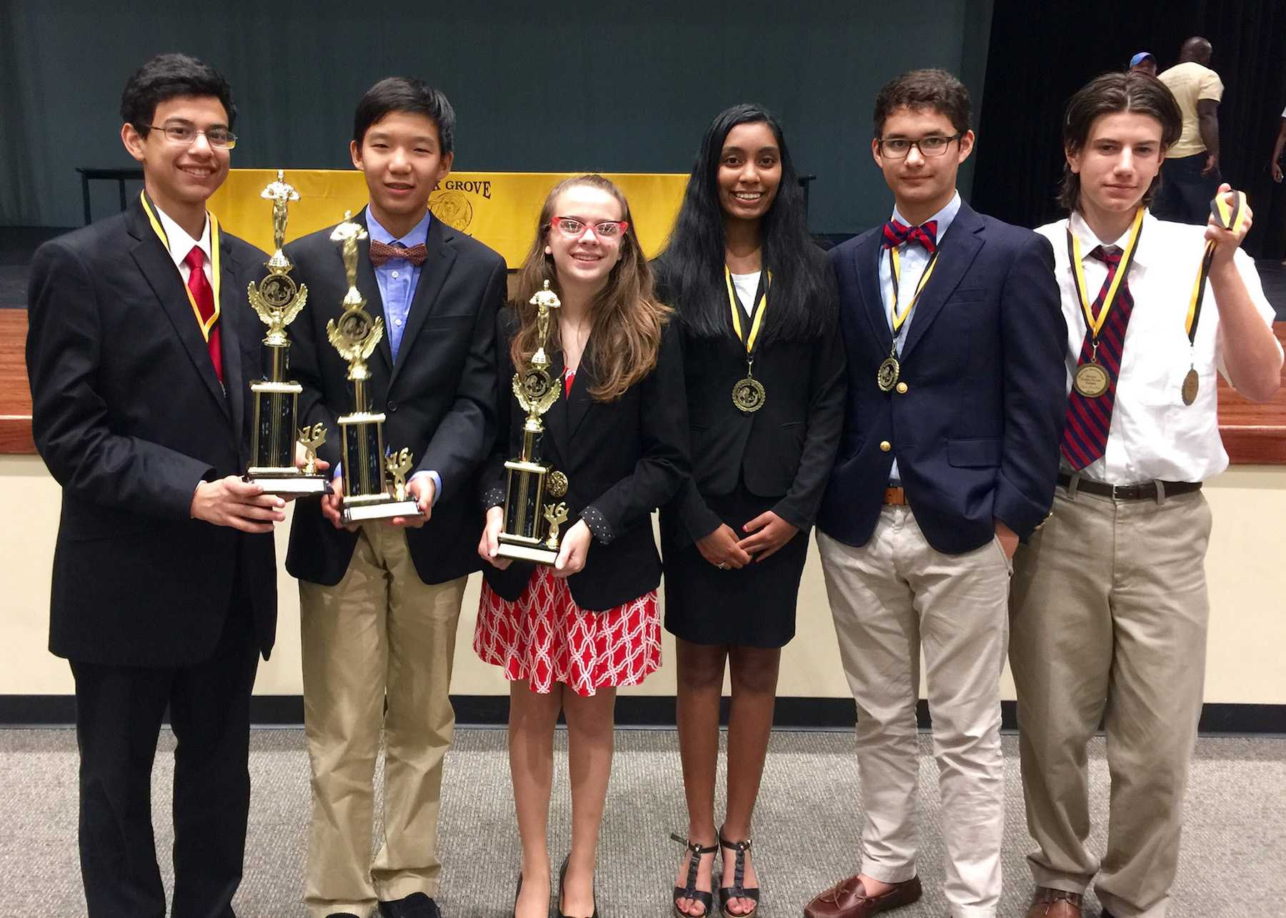 (from left to right) Sophomore Marawan Elghory, freshman Edward Hu, sophomore Edith Marie Green, junior Akshaya Vijaysankar, senior Dylan Howard, and freshman Toby O'Donnell pose with their awards at the first debate tournament of the school year.