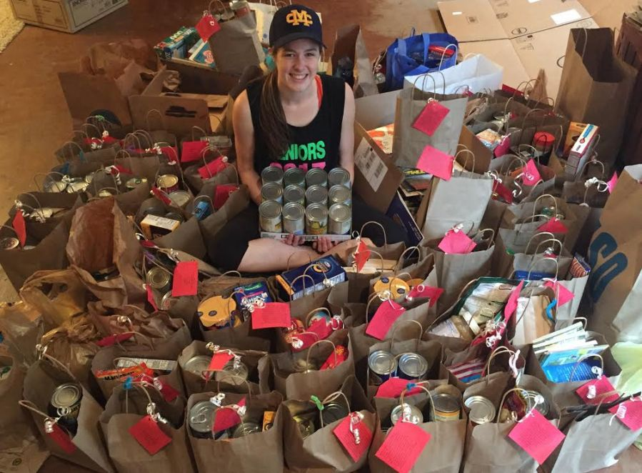 Senior+Swayze+Elliott+sits+among+cans+that+she+collected+for+a+neighborhood+food+pantry+drive.
