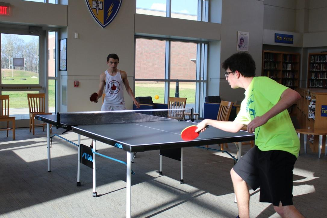 Senior Kyle Rock (left) and junior Bennett Brown (right) compete in the final round of the table tennis tournament held on March 28 to determine who would be the first place winner.