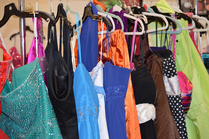 Dresses+donated+by+members+of+the+Oxford+community+hang+at+the+%22Say+Yes+to+the+Dress+--+Prom+Edition%22+event+held+at+OHS+on+March+9.+
