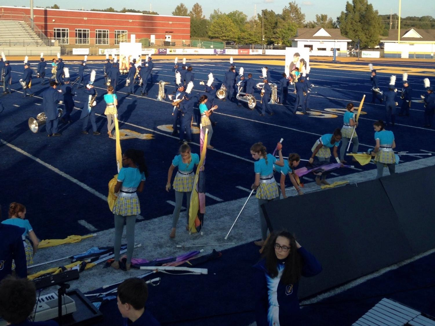 Band and color guard members take the field Oct. 14 at the regional competition.