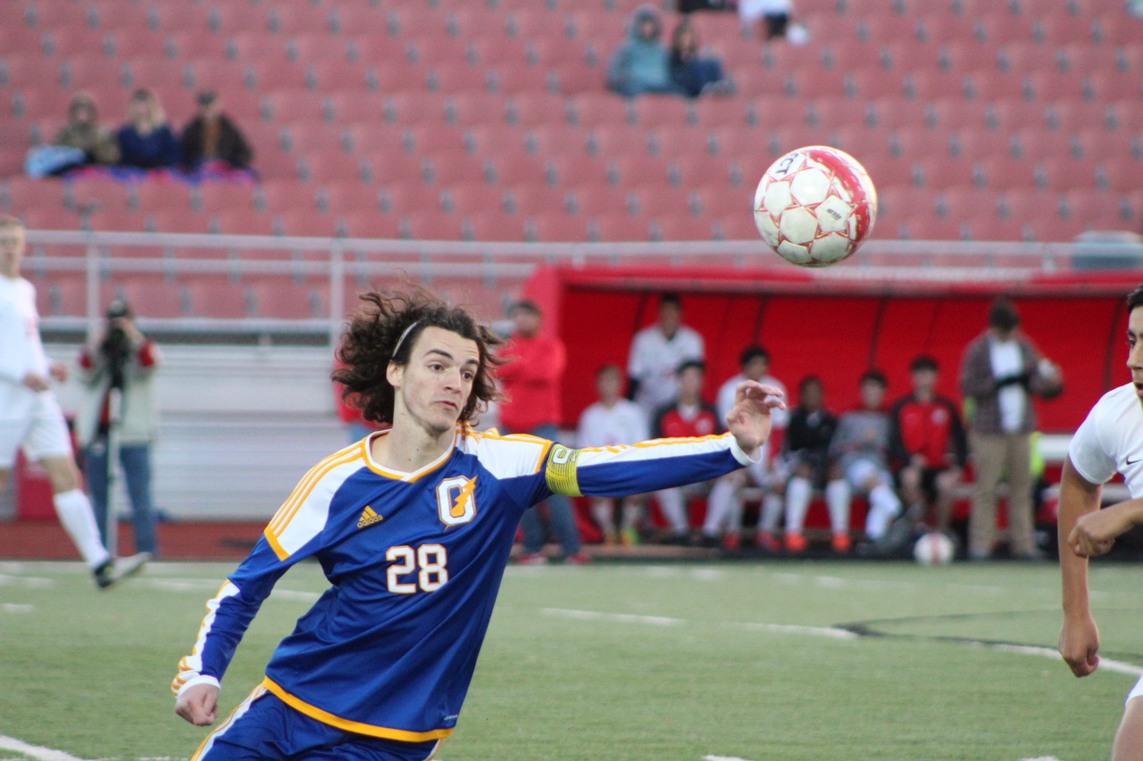 Senior Keaton Calhoon goes for the ball during the team's game against Lafayette. He broke the season scoring record which was previously 26 goals during the game against Tupelo.