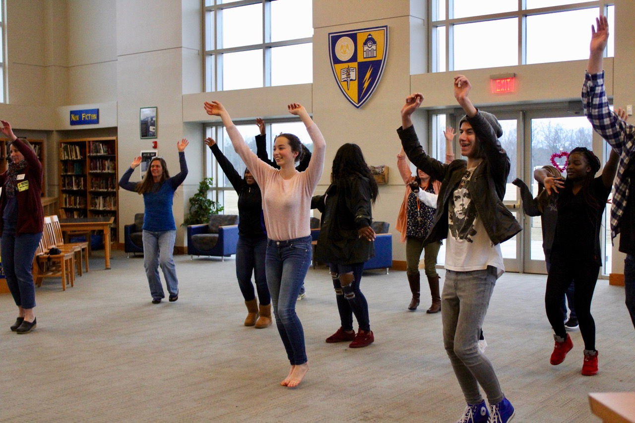 sophomores Sophie Quinn and Jupiter O'Donnell do the warmup dance at Moving Metaphors. The event was held on Feb. 6 in the library.