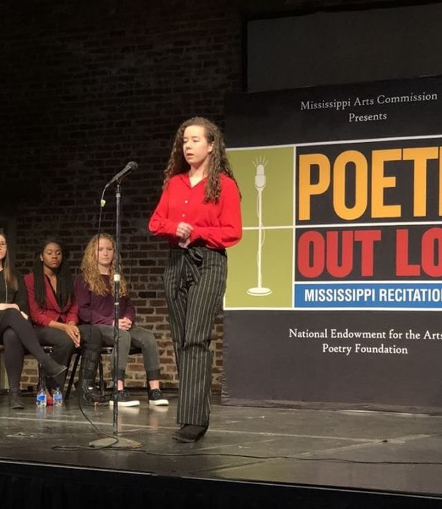 Junior Anna Claire Franklin recites her poem in the Regional Poetry Out Loud contest. She won first in the competition and will compete in the state competition March 6.