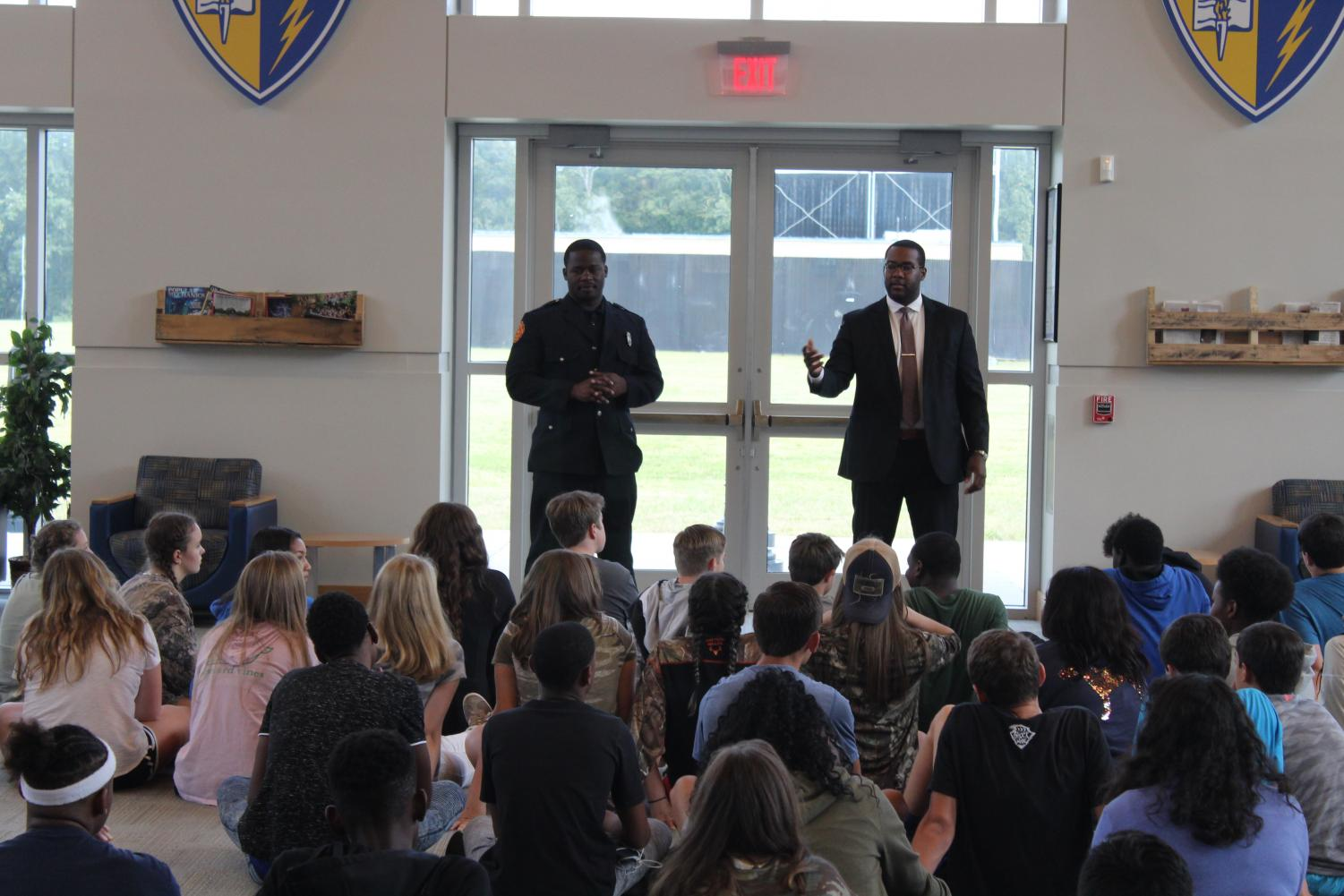 Firemen Jamie Phillips and Keveon Taylor talk to the ninth grade Personal Leadership course. They came to talk about leadership qualities as 9/11 approaches this year.