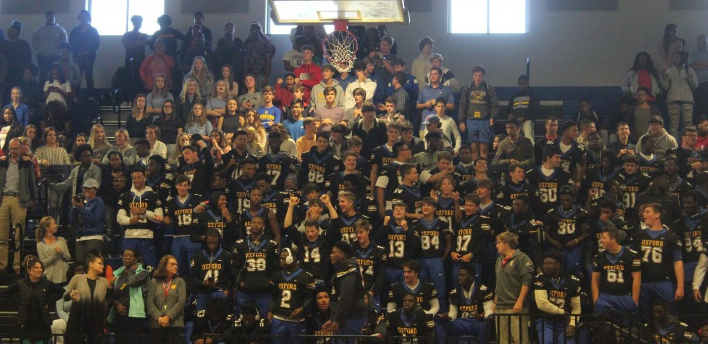 The Oxford Chargers football team cheers during the Homecoming pep rally before their game against Columbus. The Oxford Chargers won last year's game against Columbus with a score of 17-7.