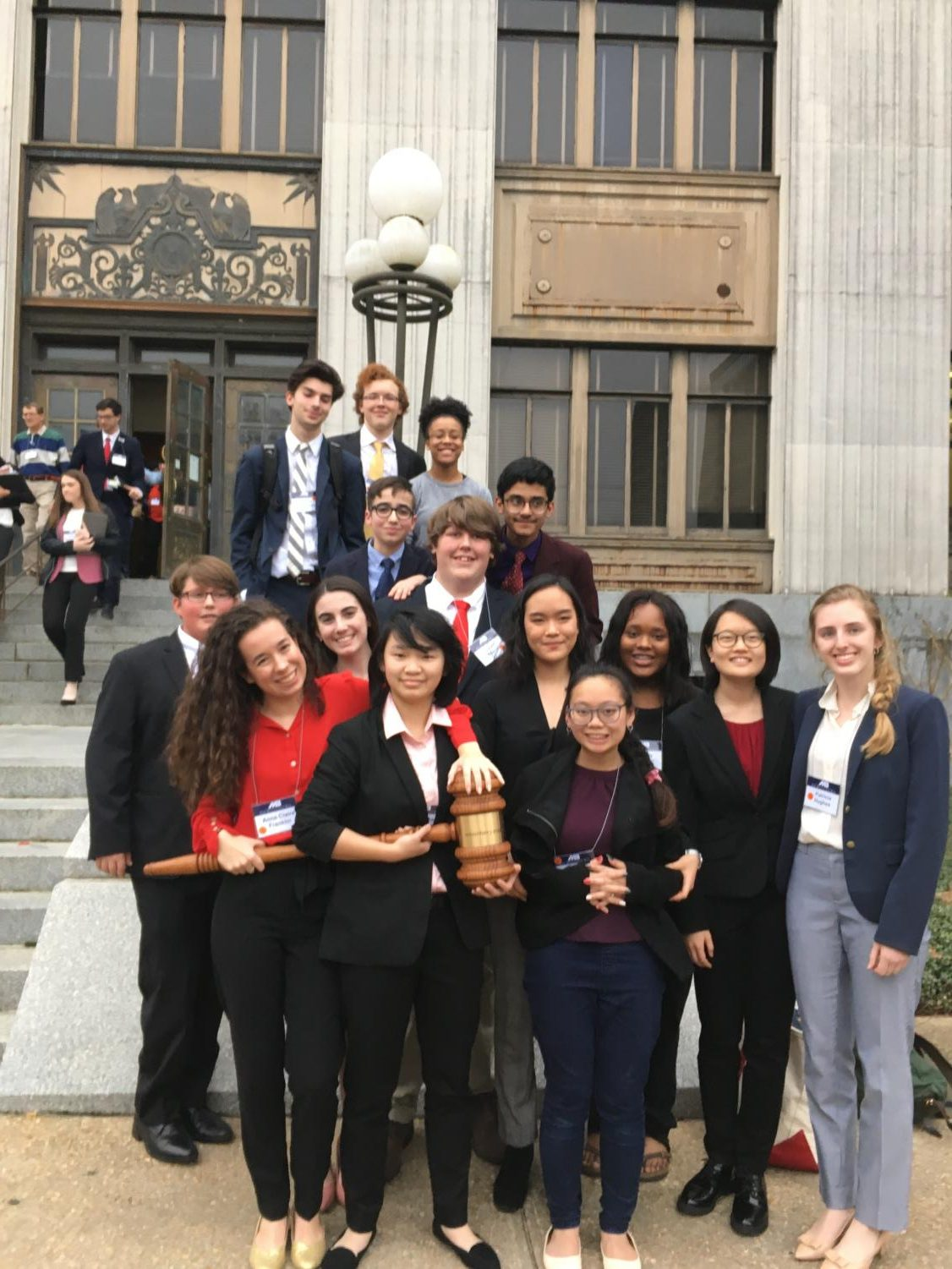 Members of the Mock trial team stand and smile with their awards from the state competition. The team placed fourth at the state competition on .