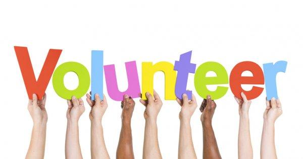 depositphotos_63075279-stock-photo-hands-holding-the-word-volunteer