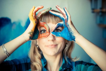 Play is integral to beginning and ending a creative dream project, here is an artist making a playful face in her studio