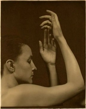 Stieglitz photo of Georgia O'Keeffe holding up her hands. 6 Business Tips For Artists from Georgia O'Keeffe.