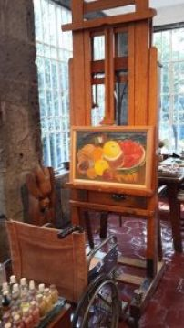 Photo of Frida Kahlo's easel and wheel chair in her house Casa Azul