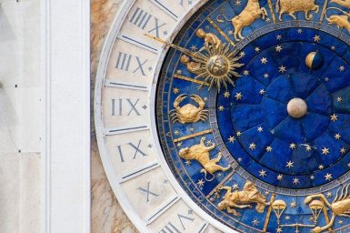 Beautiful lapis blue astrological clock on the face of St.Mark's in Rome