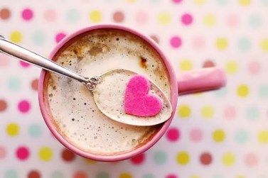 cup of coffee with cream and a pink heart candy. How to feel better and comforted when people unsubscribe from your blog.