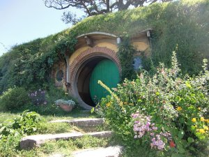 Photo by W. L. Tarbert. Door of Bag End hobbit hole, near Matamata, New Zealand. Where I imagine The Charmed Studio is set.