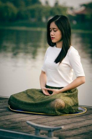 meditations for artist post, image of meditator on lake shore