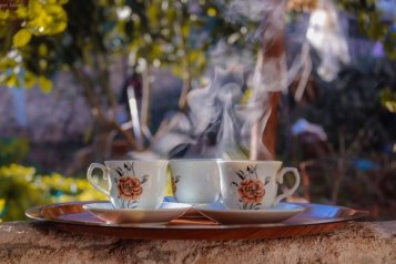 tea with floral mugs and saucers in garden. Community of people.Art Blogging helps you create authentic community for yourself and others.