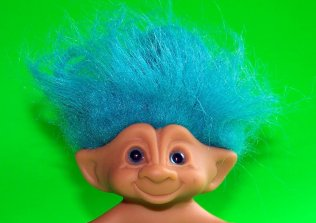 image of a blue haired, unsubscribe mailchimp pixie/troll
