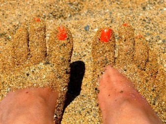 toes happily wiggling in the sand, free from worrying about approval