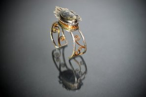 "Artist and veteran Lindsay Zike's ring : ""Secrets to Keep"" 2014. By <a href=""http://www.zikestudios.com"">Lindsay Zike</a>.  Sterling Silver, Fine Silver, Copper, Apache Gold. Photo by James Zike."