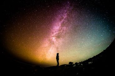 person looking up into a galaxy full of stars. Jonah complex article.