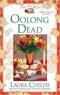 """One of dozens of <a href=""""https://amzn.to/2SB1KTO"""">Laura Child's tea-themed murder mysteries</a>. They ain't Proust but they are great for cold winter nights."""