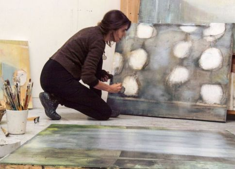 """Fine artist and Charmed Studio subscriber <a href=""""https://www.laurenmantecon.com"""">Lauren Mantecon</a> working on a painting in her New Mexico studio. (Banner Image.)</strong>"""