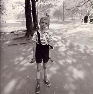 """Child with Toy Hand Grenade in Central Park,"" by Arbus 1962."
