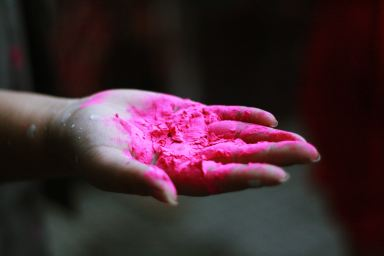 Magenta paint covered hand, for Blog post topics for artists post
