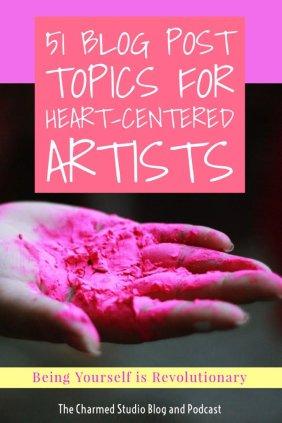 Hand holding fascia pink paint pigment, 51 art newsletter topics for heart centered artists, charmed studio blog