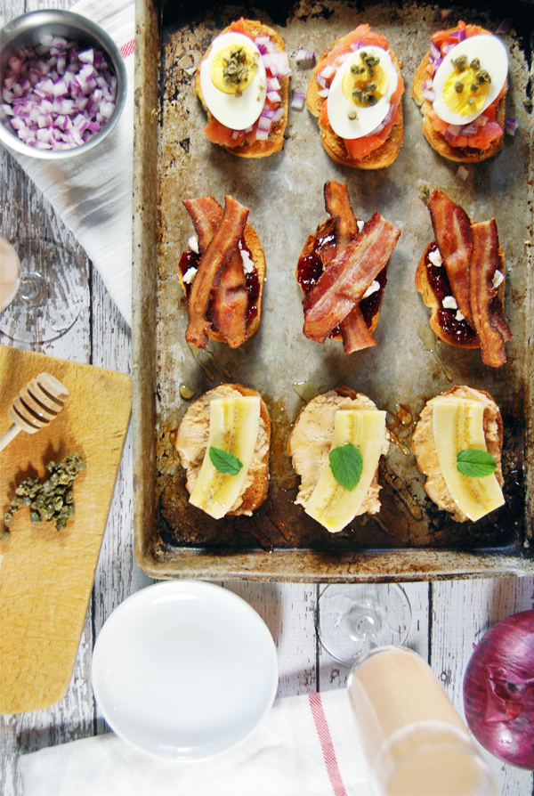 A Breakfast Bruschetta Trio - Impress your friends and family with a unique take on breakfast! This breakfast bruschetta trio features peanut butter and banana, bacon, and smoked salmon!