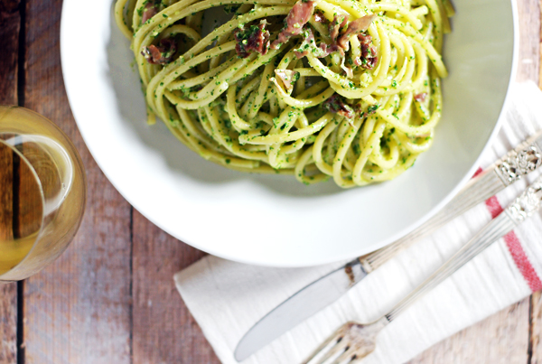 Creamy Kale Pesto Bucatini with Prosciutto: Pesto gets an upgrade with ricotta cheese, prosciutto, and kale in this easy weeknight pasta side dish.