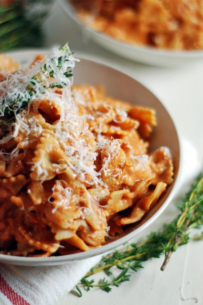 This creamy tomato pasta sauce features ricotta and fresh thyme, and is paired with farfalle.