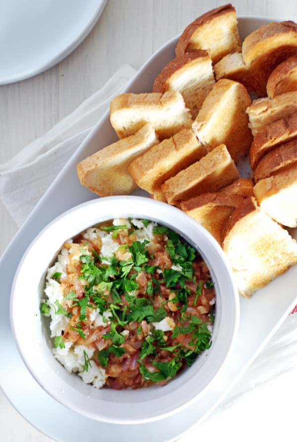 This simple goat cheese dip will impress your friends and is paired with a champagne shallot vinaigrette and crispy crostini!