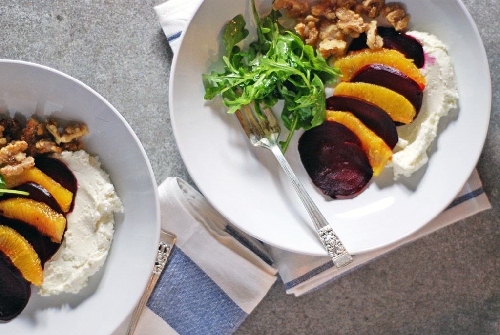 This roasted beet and orange salad is paired with creamy whipped goat cheese, quick candied walnuts, and a simple arugula greens salad.